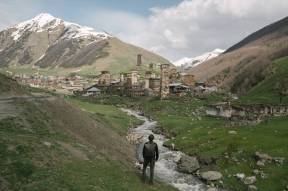 photo of man standing near river